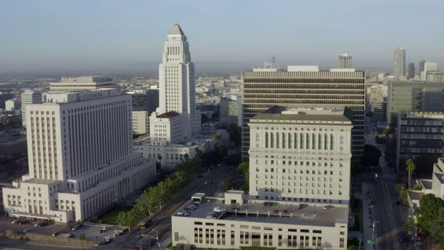 high elevation aerial back: los angeles city hall in early morning in downtown la with light traffic - tower stock videos & royalty-free footage