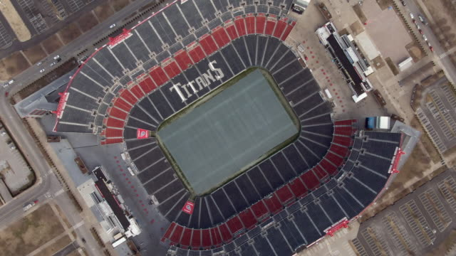 high elevation spinning aerial: nfl football stadium in nashville - stone object stock videos & royalty-free footage