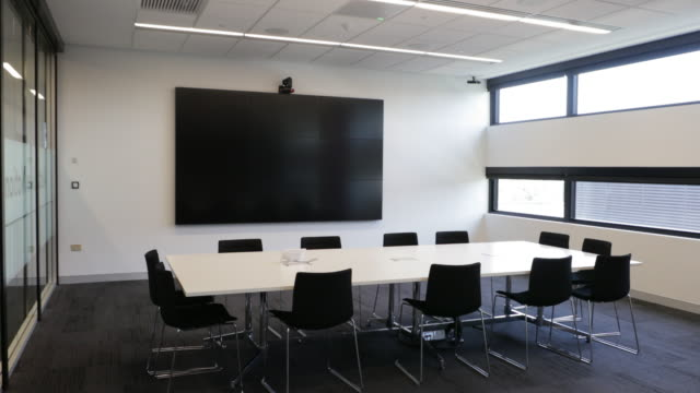 high end business facility with an interactive information wall - conference table stock videos & royalty-free footage