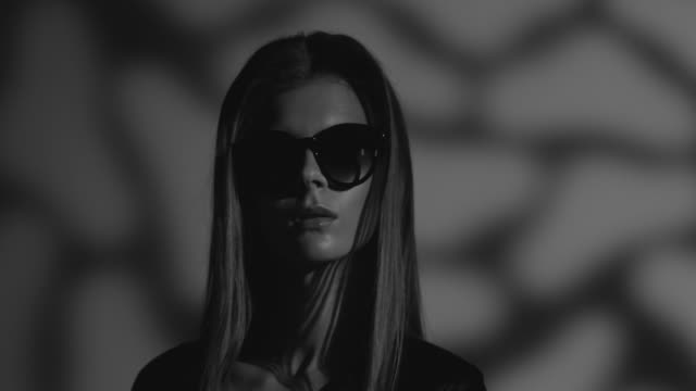 high fashion blond model in sunglasses dressed black moves. fashion video. black and white. - lace textile stock videos & royalty-free footage