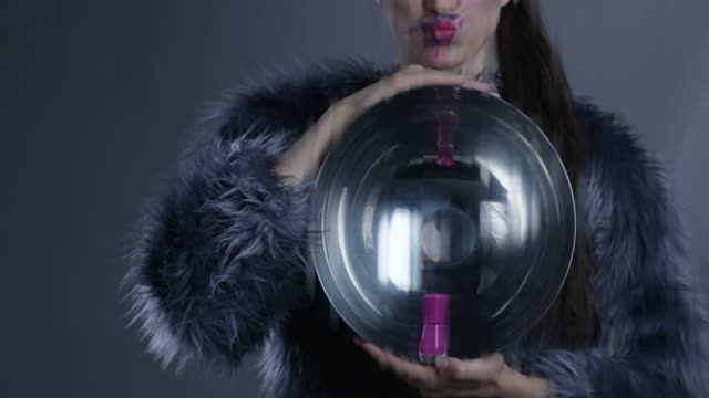 high fashion model in fur holds silver platter and pink nail polish, makes a face. fashion video. - silver platter stock videos and b-roll footage