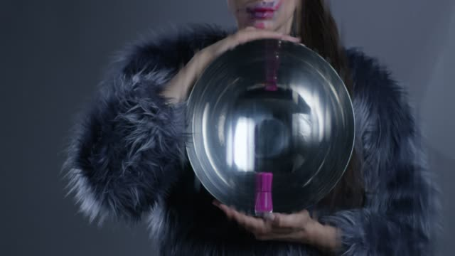 high fashion model in fur holds silver platter and pink nail polish. fashion video. - silver platter stock videos and b-roll footage