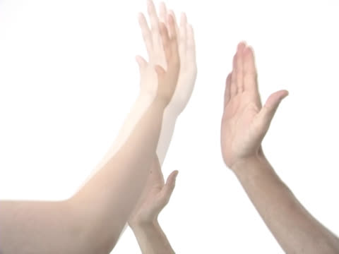high five slap of two hands - gestikulieren stock-videos und b-roll-filmmaterial