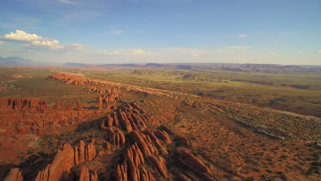high flying shot over the tower arch at the arches national park - moab utah stock-videos und b-roll-filmmaterial