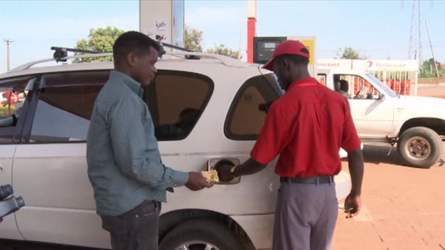 high fuel prices in uganda are crippling motorists but help is now at hand in kampala with a smartphone app which compares the price at the pump all... - kampala stock videos & royalty-free footage
