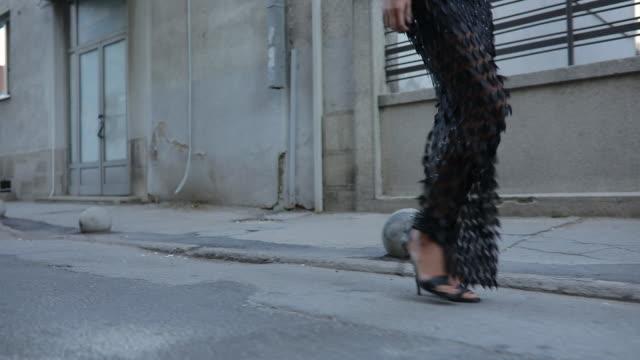 high heels on the street - vestito nero video stock e b–roll