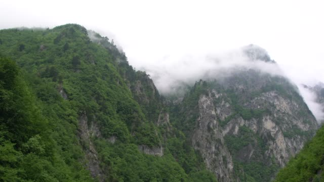high, inaccessible domineering, silver white rocks bathed in thick fog at prokletije mountains (albanian alps; accursed mountains) in kosovo - off the beaten path stock videos & royalty-free footage