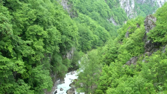 high, inaccessible domineering, silver white rocks bathed in thick fog appear in prokletije mountains (albanian alps; accursed mountains) in kosovo - off the beaten path stock videos & royalty-free footage