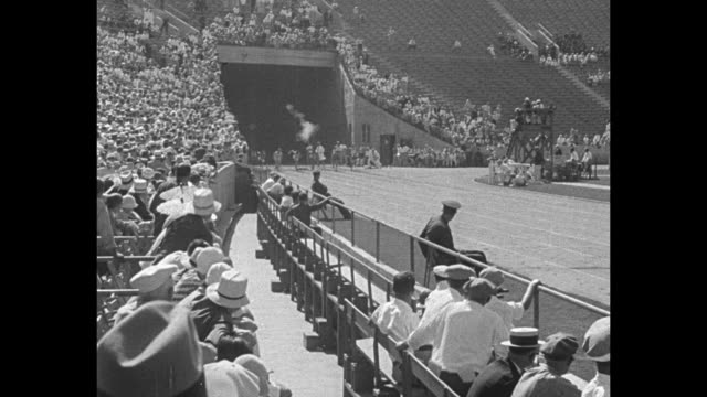 high jumper at 1932 summer olympics in los angeles / 100 meter dash with eddie tolan winning / woman aims javelin / babe didrikson runs with aims... - lanci e salti femminile video stock e b–roll
