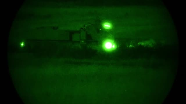 high mobility artillery rocket system vehicles with the 1st battalion 623rd field artillery regiment kentucky army national guard participate in... - night vision stock-videos und b-roll-filmmaterial