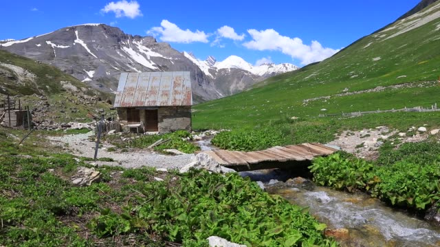 high mountain spring atmosphere in the galibier pass area on may 20, 2020 in valloire, france. - durevolezza video stock e b–roll