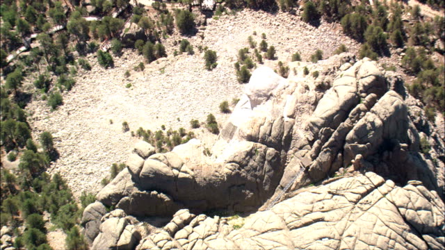 high over mount rushmore  - aerial view - south dakota,  pennington county,  united states - mt rushmore national monument stock videos and b-roll footage