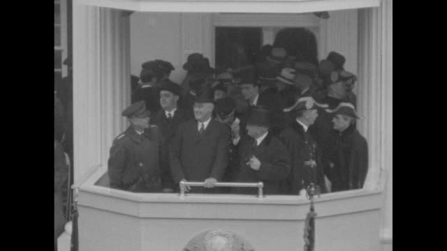 high overhead shot of parade / closer shot of military band marching down street / pres. franklin roosevelt in reviewing stand with other officials... - civilian conservation corps stock videos & royalty-free footage