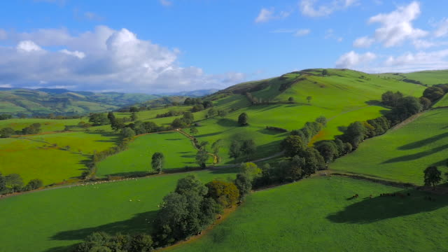 high panning aerial drone footage of welsh countryside - wales stock videos and b-roll footage