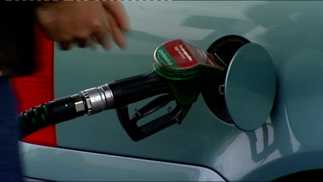 high petrol prices affecting employment england ext close shot of shell petrol station sign advertising vpower and fuelsave tilt up to prices 1359... - unleaded stock videos and b-roll footage