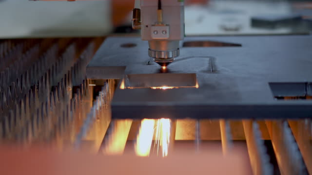 high precision cnc laser cutting metal sheet with bright sparkle in factory - metal plate stock videos & royalty-free footage
