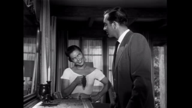 vidéos et rushes de 1952 a high pressure saleswoman receives payment for providing information to a curious guest at an inn - 1952
