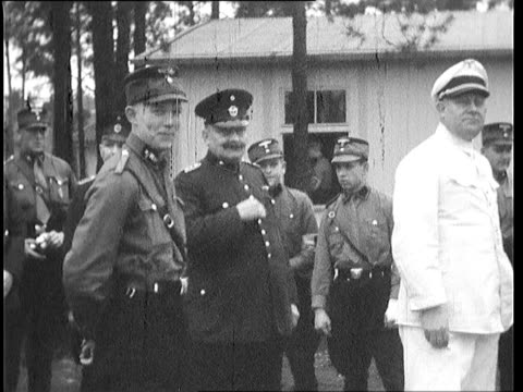 high ranking nazi officers of various groups talk outside barracks; soldiers get back onto trucks; some climb through window into barracks - mid adult stock videos & royalty-free footage