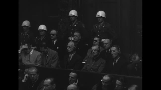 mls high ranking nazis listen to testimony at nuremberg war crimes trial german deputy fuhrer rudolf hess wobbles dizzily in his seat german foreign... - war crimes trial stock videos and b-roll footage