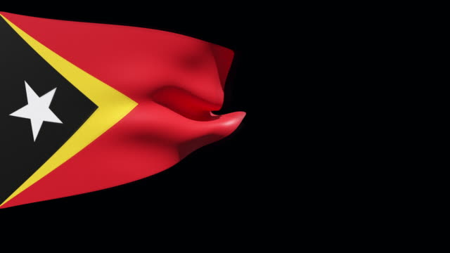 high resolution video of a 3d rendered east timor flag, moving on a black background. - westernisation stock videos & royalty-free footage