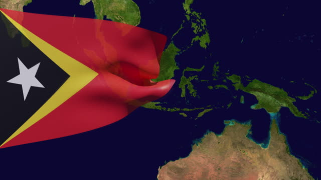 high resolution video of a 3d rendered east timor flag, moving over the country's map. - westernisation stock videos & royalty-free footage