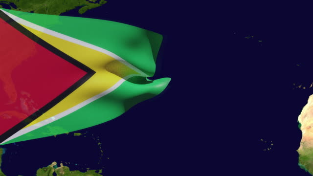high resolution video of a 3d rendered  guyana flag, moving over the country's map. - guyana stock videos & royalty-free footage