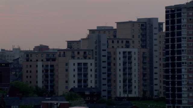 high rise apartment buildings form a residential neighborhood in newcastle upon tyne. available in hd. - newcastle upon tyne stock-videos und b-roll-filmmaterial