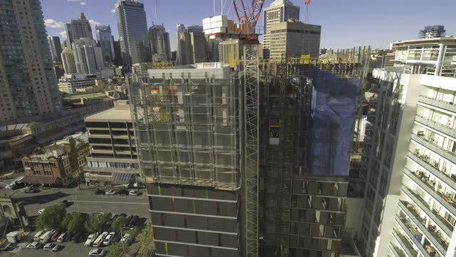 a high rise building being constructed over several months - building activity stock videos & royalty-free footage