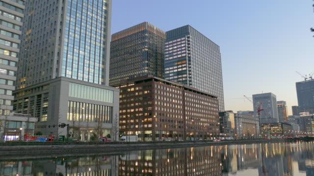 high rise buildings at marunouchi in tokyo, japan - marunouchi stock videos & royalty-free footage