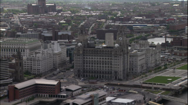 high rise buildings line the waterfront in liverpool, england. - merseyside stock videos & royalty-free footage