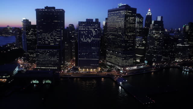 High rise buildings make up the skyline of New York City at night.