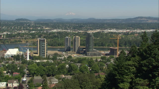 WS ZO High rise condo towers near Willamette River, Mount Hood in distance / Portland, Oregon, USA