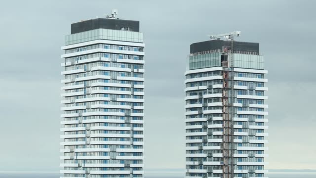 high rise condominiums stand near lake ontario in toronto ontario canada on friday may 26 2017 shots wide shot of toronto with many buildings on... - standing water stock videos & royalty-free footage