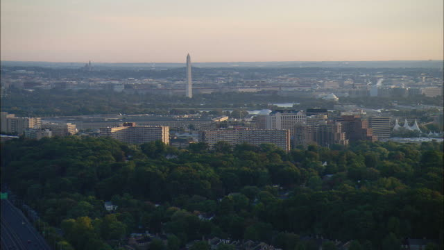 AERIAL High rise condos in Washington D.C. suburbs at Arlington, Pentagon, Washington Monument, and Jefferson Memorial in distance, Virginia, USA