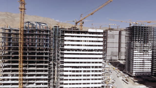 high rise construction site west tehran aerial - tehran stock videos and b-roll footage