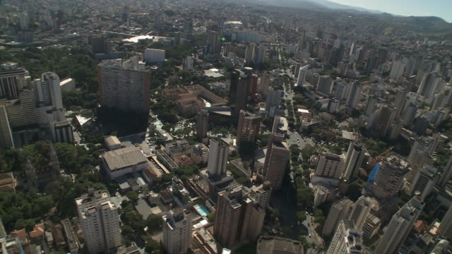 high rises crowd the sprawling city of belo horizonte, brazil. - belo horizonte stock videos and b-roll footage