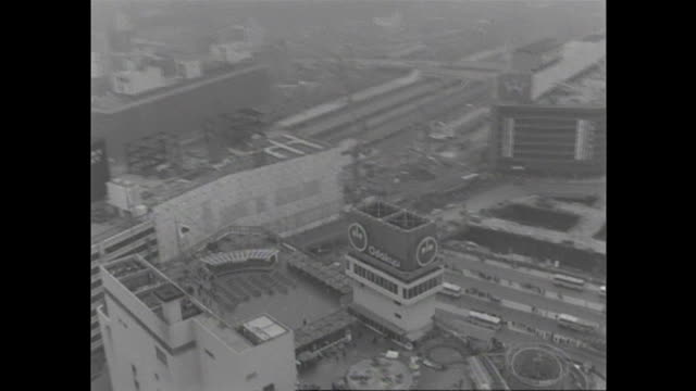 high rises surround shinjuku station in postwar tokyo. - postwar stock videos & royalty-free footage