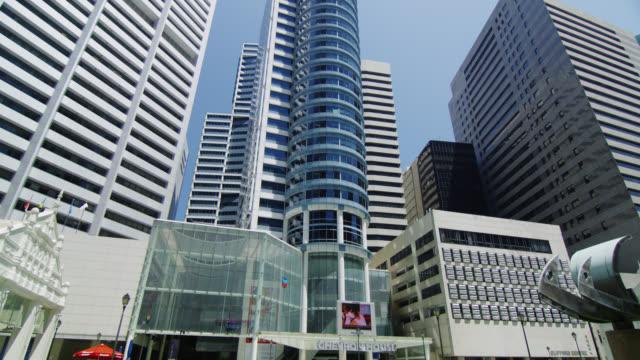 high rising buildings at raffles square, tilt up, daytime, singapore - tilt stock videos & royalty-free footage