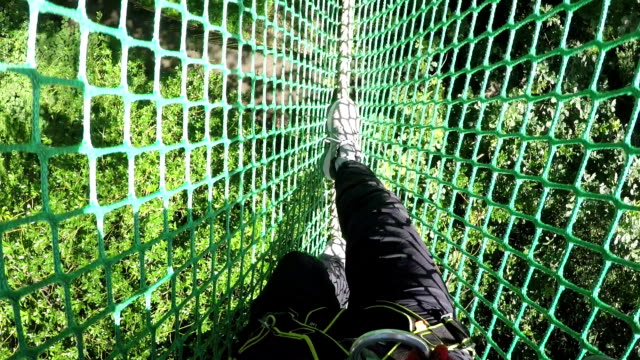 high ropes / assault course walking on netting - rope stock videos & royalty-free footage