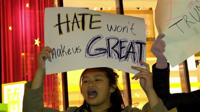 vídeos de stock, filmes e b-roll de high school age teenagers against trump / anti donald trump protesters gathered outside of trump tower on 5th avenue in opposition to donald trump's... - new age