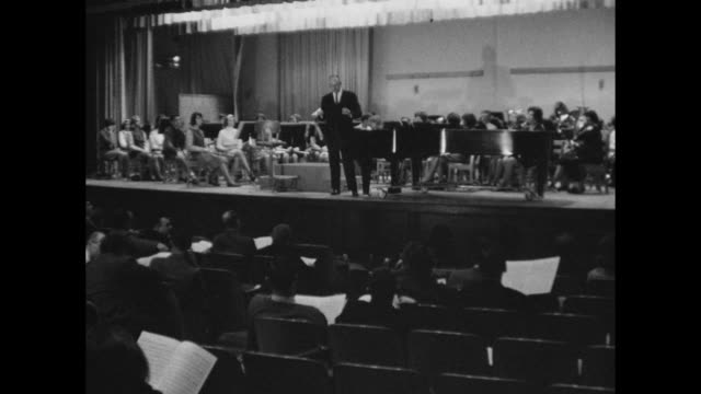 high school band rehearsal in concert hall or auditorium in nashville - conductor stock videos and b-roll footage