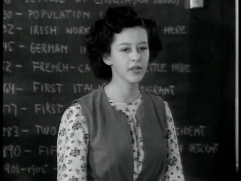 high school class girl talking about being free from persecution aunt was killed in germany because jewish students listening bulletin board posting... - school bulletin board stock videos and b-roll footage