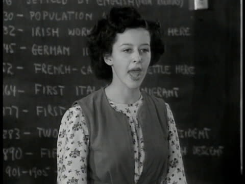 high school class, girl talking about being free from persecution, aunt was killed in germany because jewish, students listening. bulletin board... - aunt stock videos & royalty-free footage