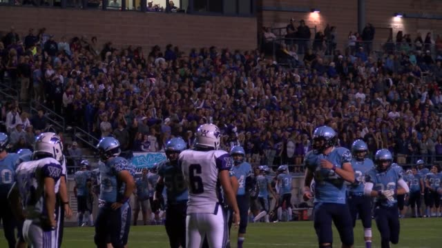 High School football action in games between Ralston Valley High School and Arvada West High School at night and Golden and Kennedy High Schools...