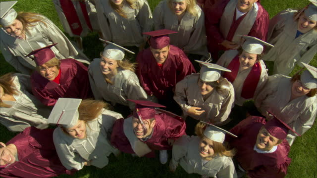vídeos de stock, filmes e b-roll de ws ha high school graduates (17-19) waving at camera and giving high fives / appleton, wisconsin, usa - 2009
