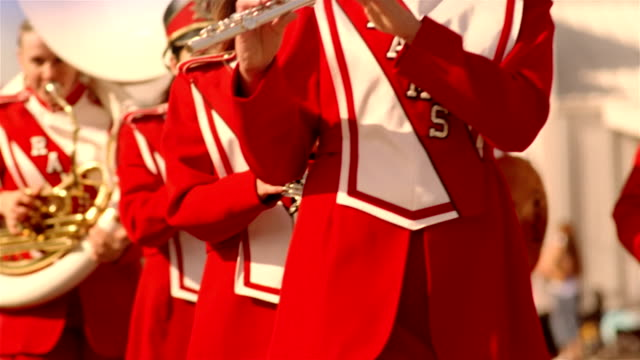 high school marching band proceeding down street in parade / california - marching band stock videos & royalty-free footage