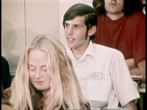 vidéos et rushes de 1973 ms high school math class, boy trying to answer question / united states - élève du secondaire