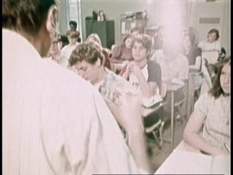 1973 montage high school math class, teacher asks for a volunteer, no one raises hand, teacher selects student / united states - high school student stock videos and b-roll footage