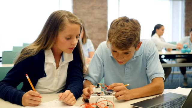 high school stem students work together on robotics project - uniform stock videos & royalty-free footage