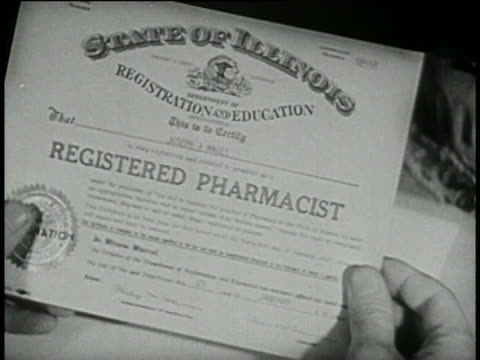 1946 - high school student working in pharmacy - diploma stock videos & royalty-free footage